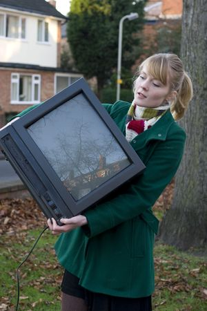Young girl holding a tv photo