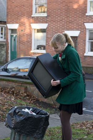 Young girl contemplating throwing her tv away photo