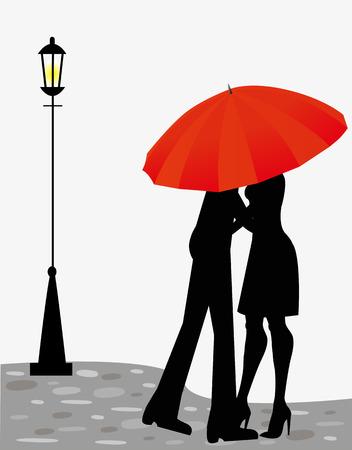 傘の下で道路上の愛のカップル