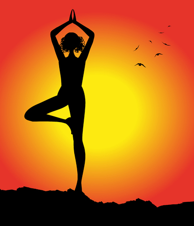 yoga sunset: woman silhouette in yoga position at sunset