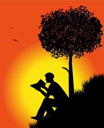 man silhouette reading a book in the sunset