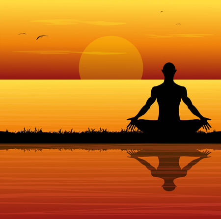 silhouette of man meditating on the beach