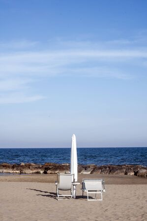 felice: chairs and umbrella on the beach in San Felice Circeo, Italy