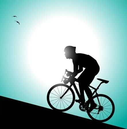 pedaling: silhouette of cyclist pedaling uphill