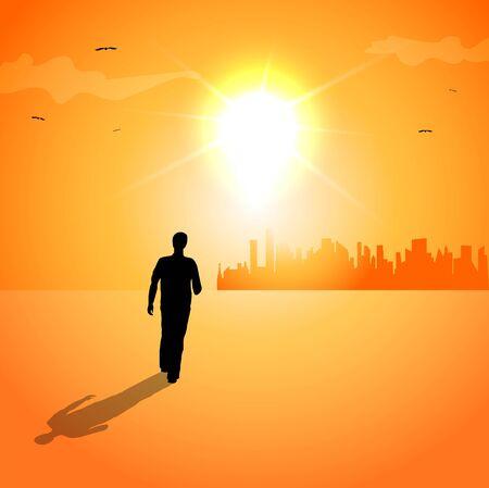 Man walking at sunset towards the city.