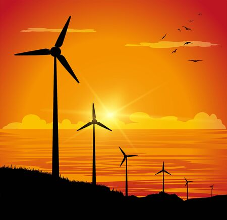 Silhouette of wind turbines and sea in the sunset background.