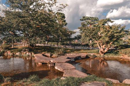 Stone bridge in a classical Japanese garden in Kenrokuen in Kanazawa Japan
