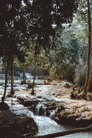 People Swimming in the Kuang Si Waterfalls in Laos Luang Prabang