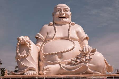 Big laughing sitting outdoor Buddha in Vinh Trang Pagoda in South Vietnam