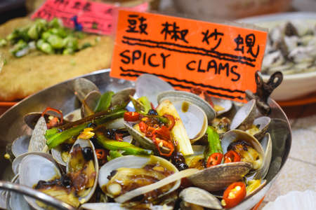Hot pot with spicy clams sold on a street market in Hong Kong China Stock fotó