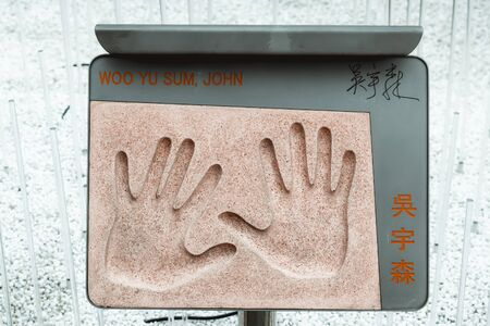 Plaque with the hand imprint of legendary Chinese action movie director John Woo placed in the Garden of Stars in Hong Kong Banque d'images
