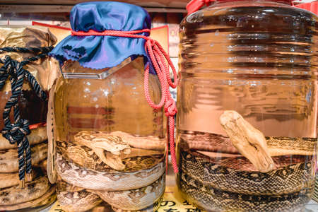 Jars with traditional Japanese alcohol with dead snake inside Stock fotó