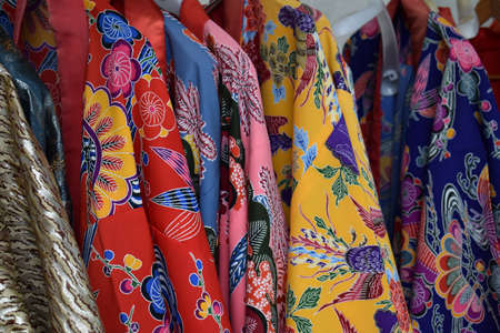 Traditional colorful red, pink, blue and yellow Kimonos from Okinawa