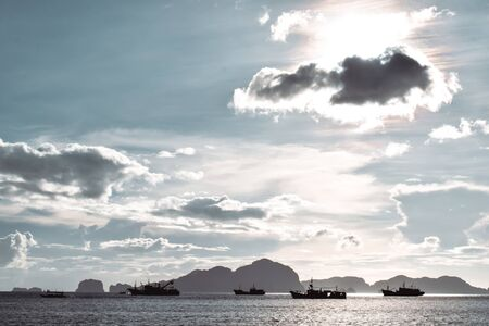 Fisherman ships cruising the sea in El Nido the Philippines under clear blue sky on a sunny day