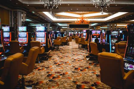 Video lottery terminals and gamblers inside the Venetian casino in Macau China