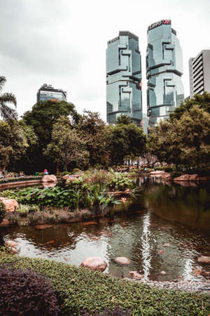 View over the Hong Kong Park with the Lippo twin buildings in the background