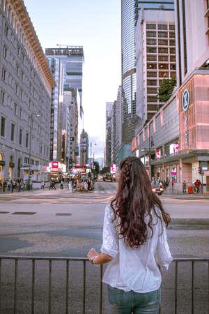 A tourist girl observing the rush of Nathan Road in Kowloon Hong Kong Sajtókép