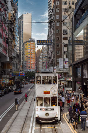 Double-decker tram on a busy street of the Hong Kong Island in China