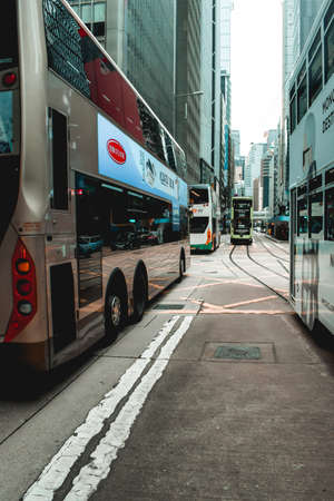 Double-decker trams and buses in the streets of Hong Kong