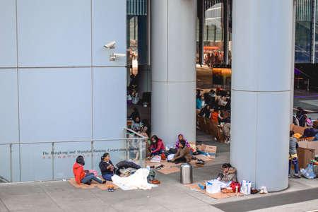 Poor immigrants camping at carton boxes in front of the Hong Kong and Shanghai Banking corporation at the Hong Kong Island