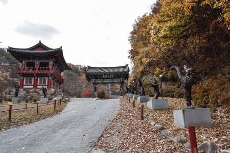 Main entrance to Golgulsa Temple in South Korea with statues of monks in martial art Sunmudo fighting poses