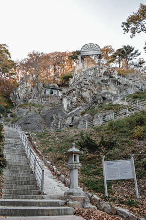 Stone staircase to the Big Buddha engraved in a stone in Golgulsa temple in South Korea