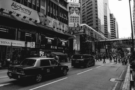 Cars and a rush on a street of Hong Kong