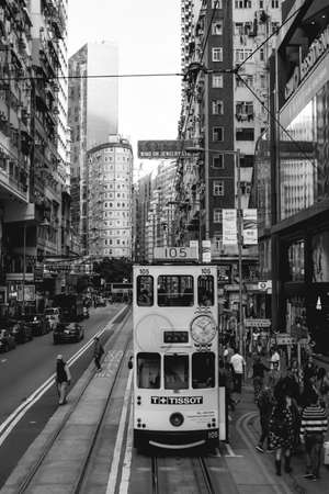 Double-decker tram in the busy streets of Hong Kong Island