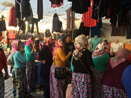clothes: Women wearing traditional clothes shopping at the bazaar