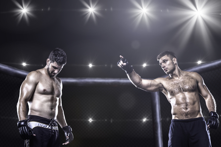 fight arena: Two mma fighters in cage before fight