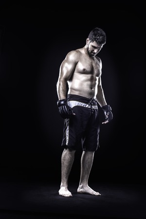 Mixed martial arts athlete isolated on black background