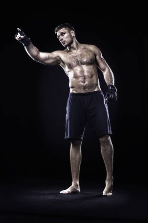 mixed martial arts: Mixed martial arts athlete isolated on black background