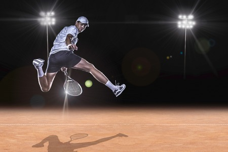 lawn tennis: Tennis player jumping for the ball behind on tennis court