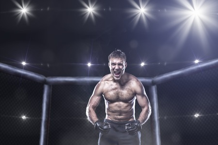 fighting arts: fighter in a mixed fight cage in rage shouting loud