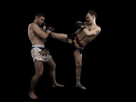 men exercising: Two caucasian men exercising traditional martial art black background Stock Photo