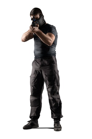 man in black military uniform aiming with rifle isolated on white background Stock Photo