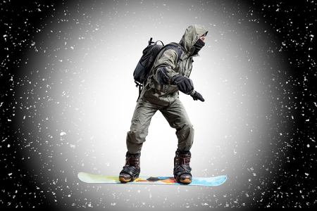 flying snowboarder on snow background Stock Photo