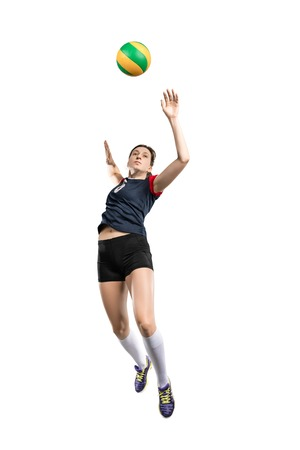 Female volleyball player hitting the ball 스톡 콘텐츠