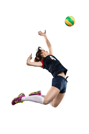 Female volleyball player hitting the ball Фото со стока