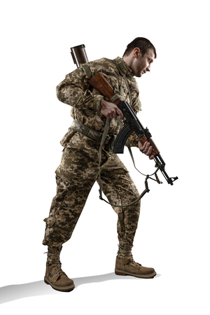 Soldier with assault rifle isolated on white