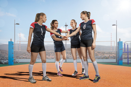 expertise: Female volleyball team celebrating victory