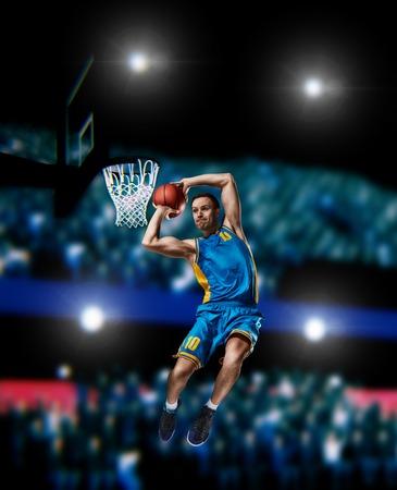 basketball player making slam dunk on basketball arena Standard-Bild