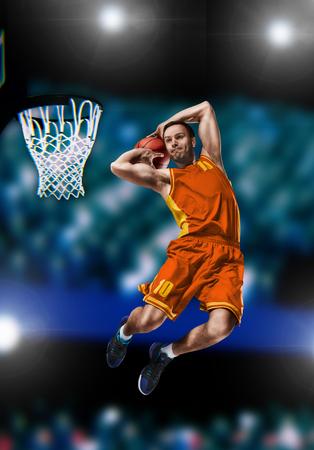basketball player making slam dunk on basketball arena 스톡 콘텐츠