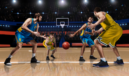 four basketball players in game action on court