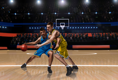 two basketball players in scrimmage during basketball match 스톡 콘텐츠