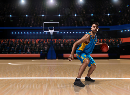 basketball player in action on basketball playground 스톡 콘텐츠