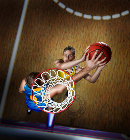basketball player is blocking shot during the match