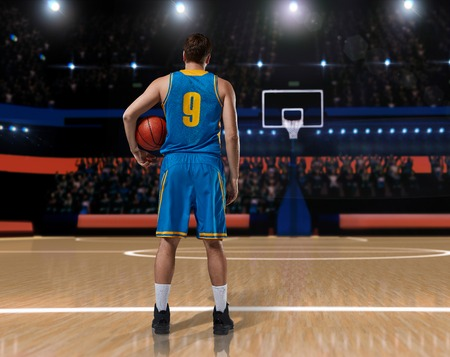 basketball player im blue uniform standing on basketball court