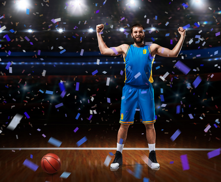 basketball player im blue uniform standing on basketball court 스톡 콘텐츠 - 114595366