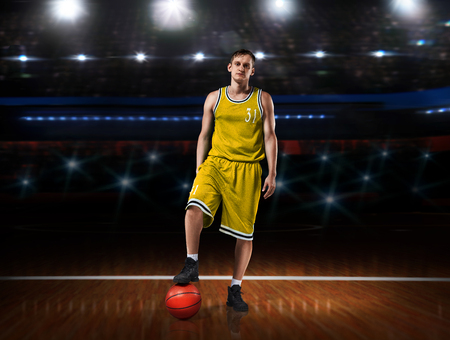 basketball player in yellow uniform standing on basketball court 스톡 콘텐츠 - 114595370